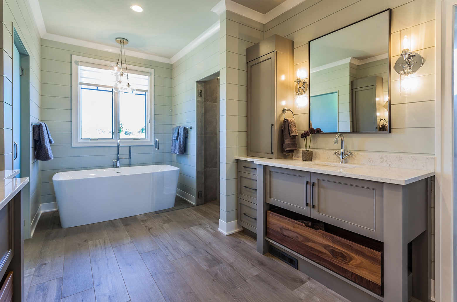 bathroom tub and cabinets